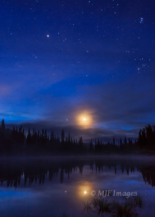 One of my favorite night images, the moon and Jupiter times two in Mt. Rainier's Reflection Lake.  Please click on image if interested in it.