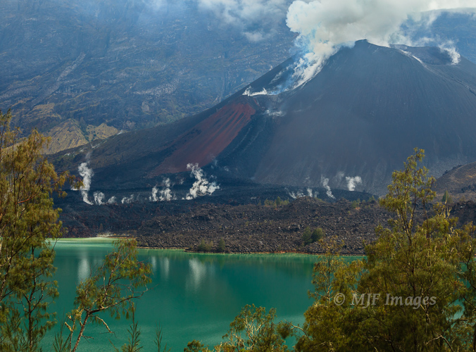 Primeval water:  This Indonesian volcano is spewing water and other gases into the air every day.  The lake color comes from all the minerals.