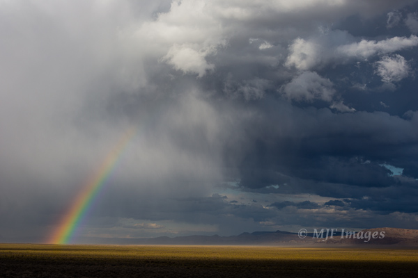 A storm moves through Oregon's Alvord Desert, and leaves behind a rainbow!