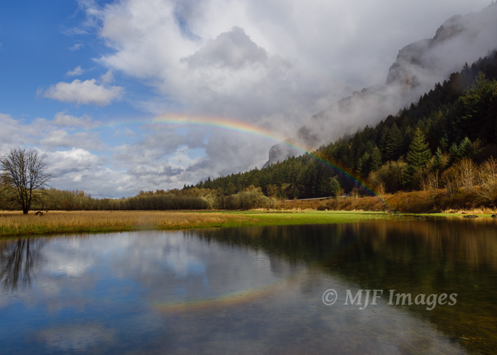 A rainbow reflected in a small lake along the Columbia River.  It was classic Oregon springtime weather that last day.