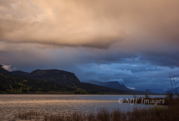 A spring rainstorm passes over the Columbia River Gorge in the Pacific Northwest.