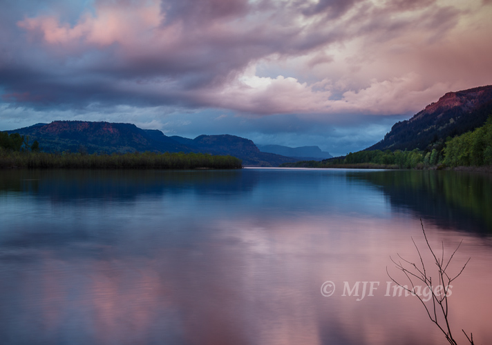 Dusk falls over the Columbia River where it flows along the border of Oregon and Washington through its famous gorge.
