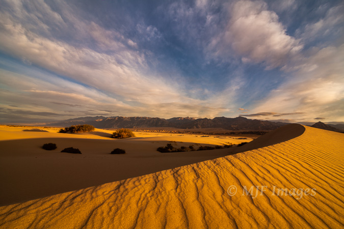 Normally the desert is a haven for high contrast, but low frontlight from the rising sun softens and evens out everything in this Death Valley image.