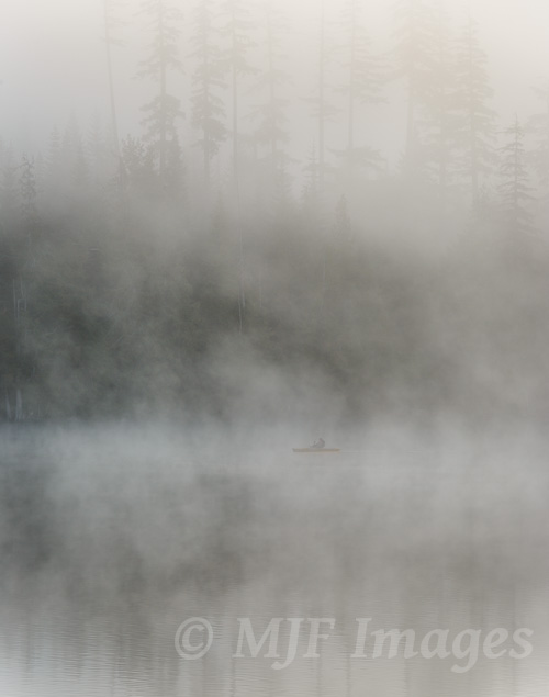 A fisherman tries his luck at Lost Lake in the dawn mist.