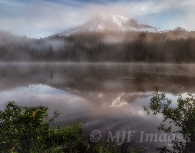 Mount Rainier emerges one foggy early morning at Reflection Lakes.