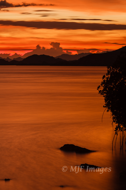 Please click on image if interested.  A glorious sunset over the Banda Sea off Flores, Indonesia.  30 sec. @f/16, ISO 100.
