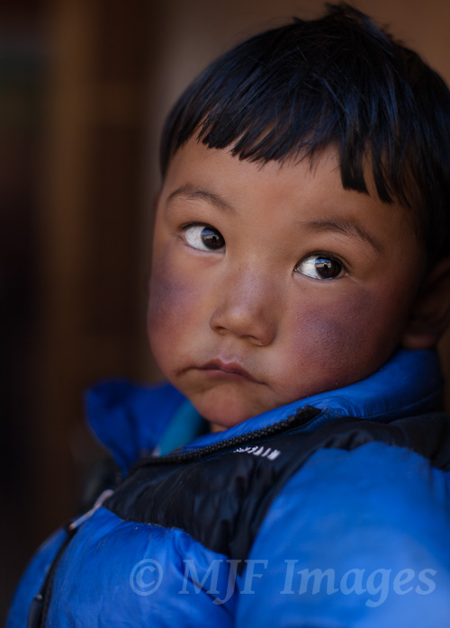 For me this little Sherpa boy makes me think of the tragedy that killed 16 Sherpas last month on Everest.  He is in the doorway waiting for his father to return.