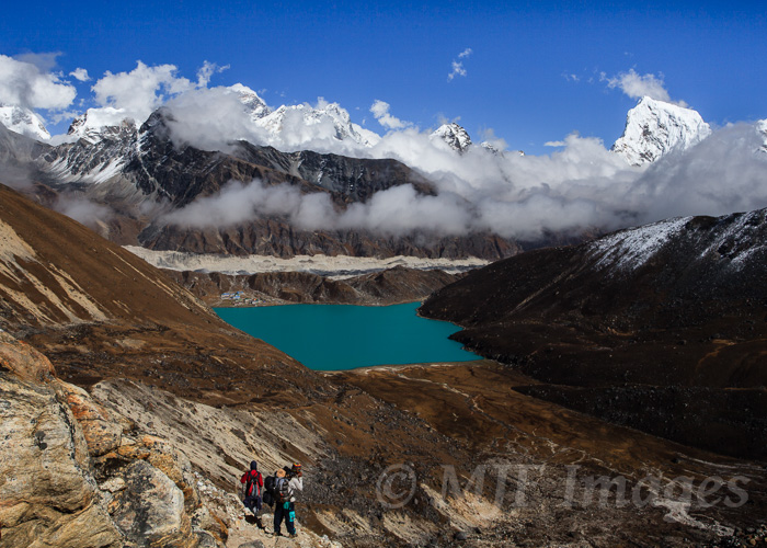 A trekking Sherpa leads his charge down to Gokyo from Renjo La in Khumbu, Nepal.