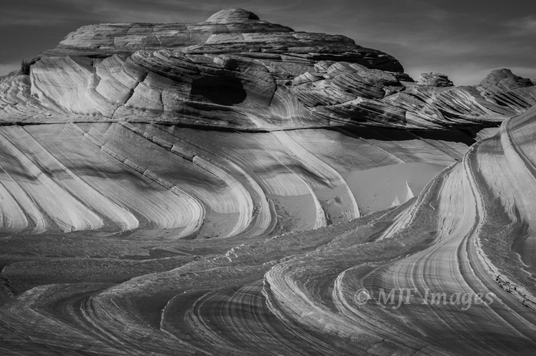 Cross-bedded sandstone in Utah's Vermilion Cliffs National Monument form beautiful curving line patterns.