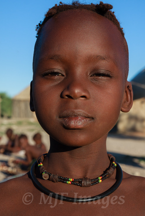 I wanted this young Himba in a Namibian village to be the star of the picture, but I also wanted the village to be noticed too, so a moderately shallow depth of field was necessary.  68 mm., 1/320 sec. @ f/8, ISO 200.