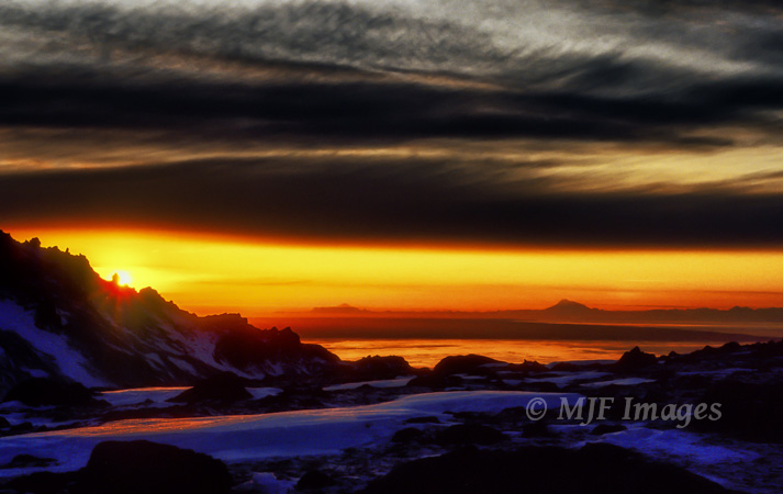 An early winter's sunset over Cook Inlet as viewed from the Chugach Mtns. just above Anchorage.