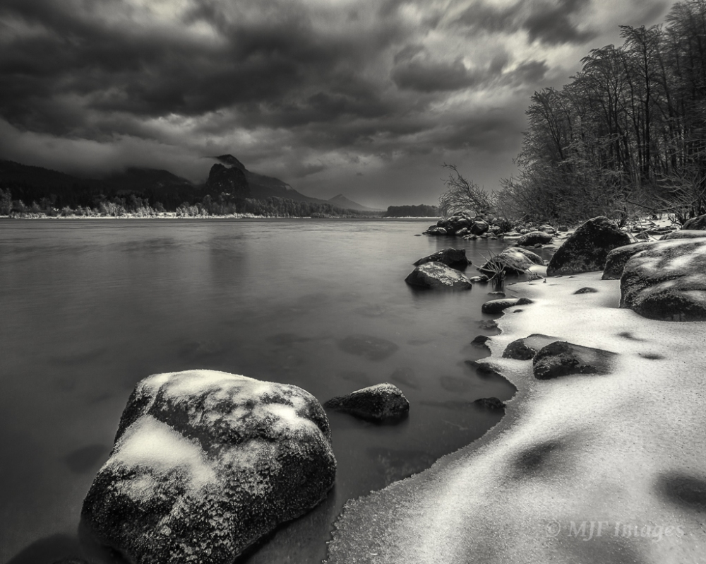 Crashing Skies:  A winter storm passes through the Columbia River Gorge, Beacon Rock sitting on the Washington side of the river.