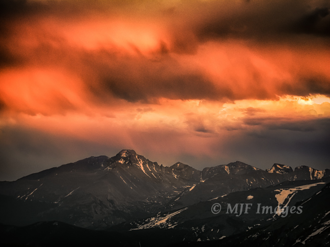 Long's Peak, the highest mountain in Colorado, catches the evening's last sunlight from high up on Trail Ridge.