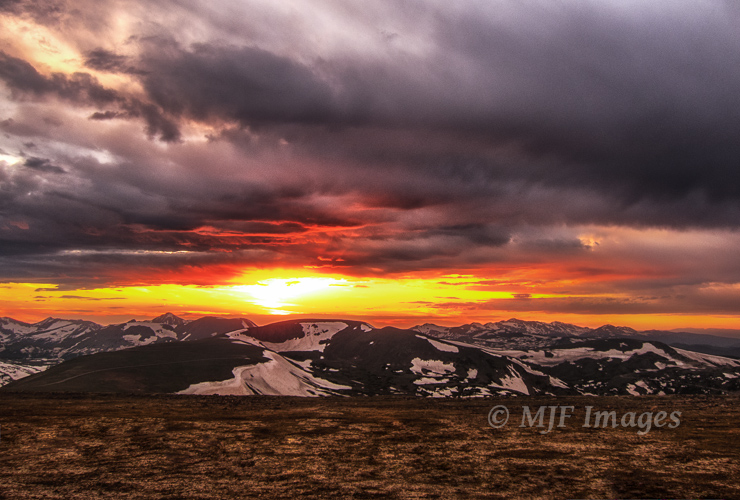 The sun sets behind the Never Summer Mountains as viewed from Trail Ridge in Rocky Mountain National Park.