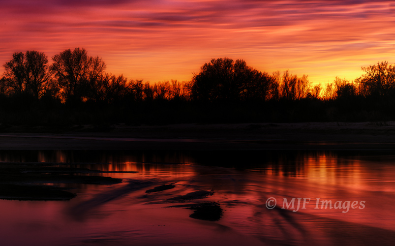 The sun has just set along the Cimarron River, OK