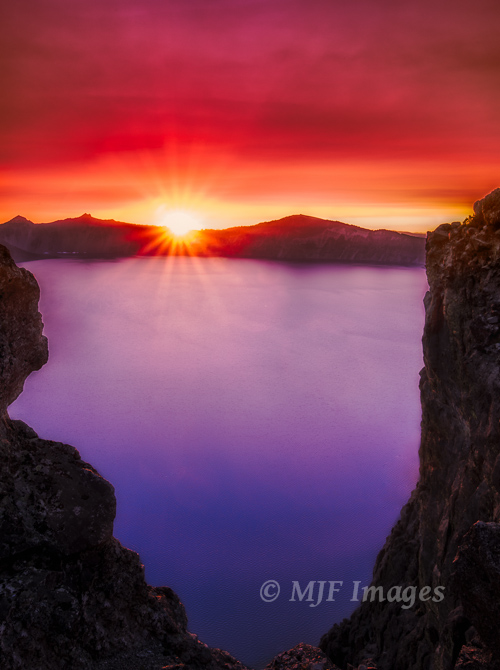 Last week I posted a winter Crater Lake.  This one is from late summer with smoke from distant fires turning the sky orange.