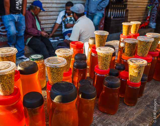 Raw miel (honey) for sale on a Mexican street.