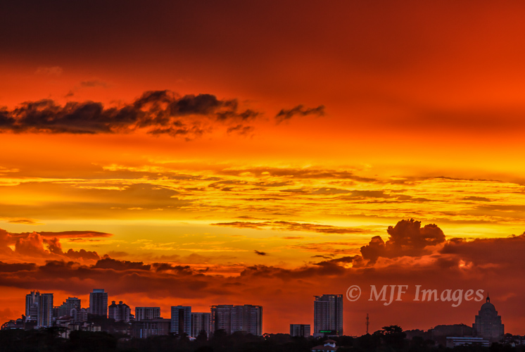 I was able to see and shoot this fiery sunset in Kuala Lumpur only because I found a way on to the roof of my hotel.
