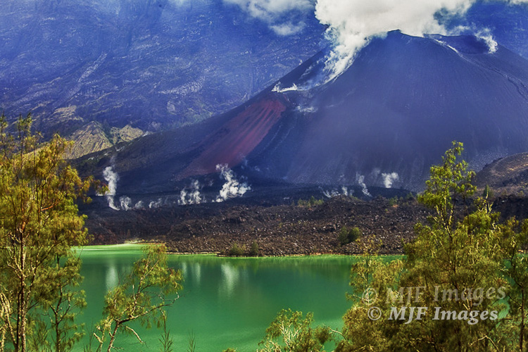 This isn't Crater Lake, it's the lake filling Rinjani Caldera, a still-active but otherwise similar volcano on the island of Lombok, Indonesia.