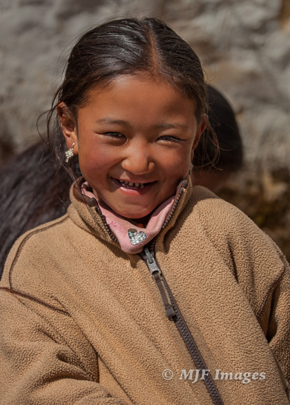 I played around with this little Sherpa girl as her mother sewed in a small sun-warmed courtyard.  She is a teenager now.