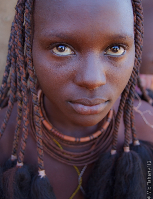 A young Himba woman in northern Namibia is more than ready for her closeup.