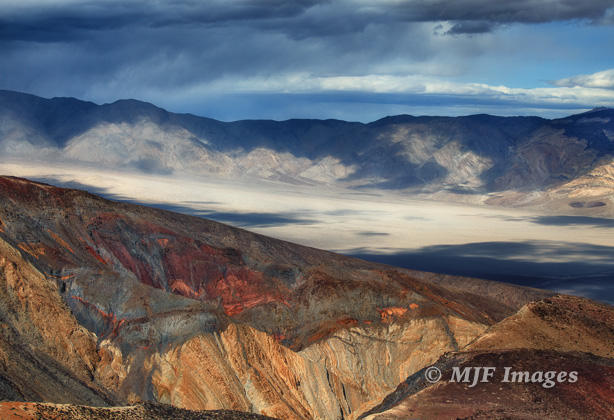 There's a lot going on in this image from Death Valley, California too:  the limestones of Rainbow Canyon in the foreground, Panamint Valley with its dunes, and distant Grapevine Mountains.