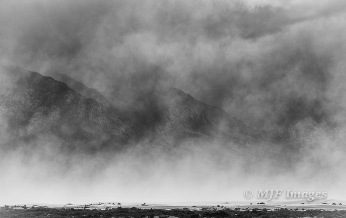 Sandstorm, Owen's Valley, California.  A quick grab without the need for a tripod, partly because I was able to use a modest aperture.  144 mm., f/8 @ 1/250 sec.