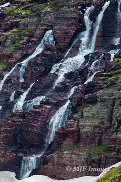 Spring is also a time of plentiful water falling down the mountainsides:  above Grinnell Lake.