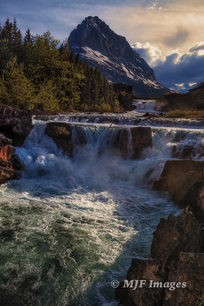 Swiftcurrent Creek spills over a raucous waterfall on its way from the lake of the same name.