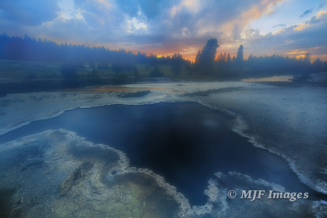 While shooting (on a tripod), I was getting hit by a big dose of steam from this hot spring along the Firehole River, Yellowstone.   16 mm., f/13 @ 1.6 sec., ISO 100.