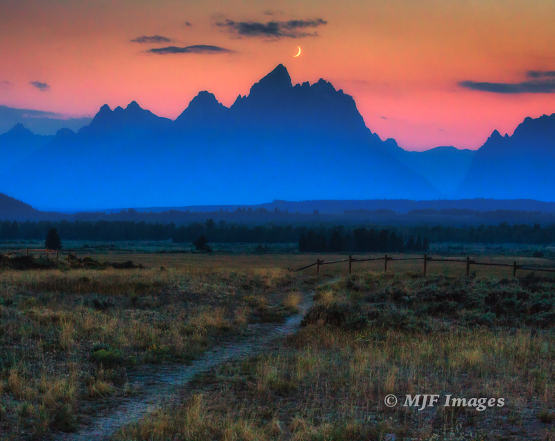 The recent crescent moon sets over Grand Teton, Wyoming.