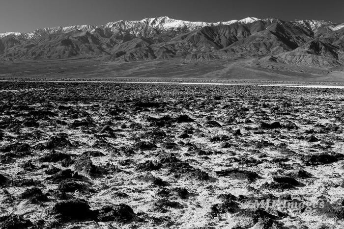 Snow-capped Telescope Peak has been lifted by the range-front fault over 11,000 feet above the floor of Death Valley.