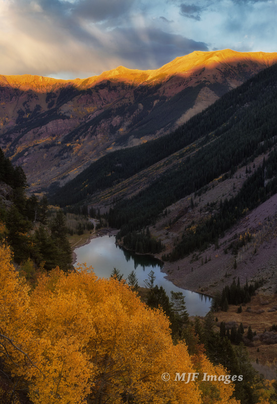 Maroon Lake sits in its aspen-lined valley, Colorado.