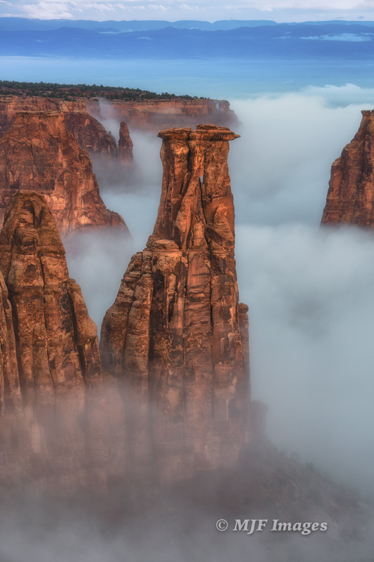 Fog-filled Monument Canyon, Colorado N.M., Colorado.