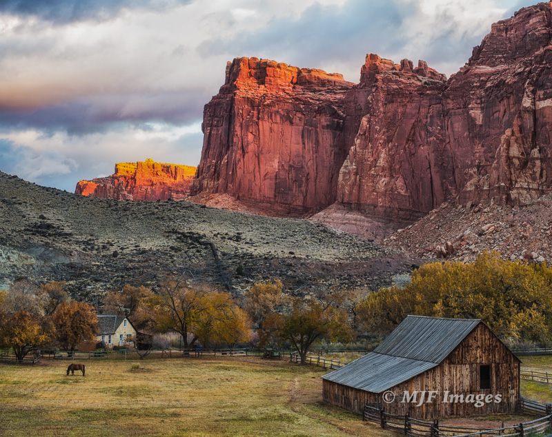 The Old Gifford Place: An historic homestead lies beneath the cliffs of Capitol Reef in Utah.
