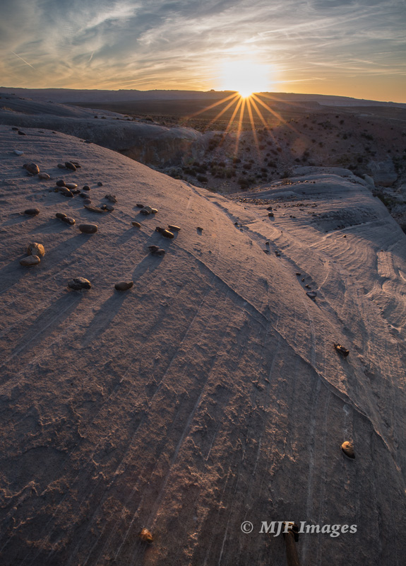 The sunstar (most call it a sunburst) is probably too prominent, but at least the subtle light/color doesn't take away from these ferric concretions eroding out of sandstone near Page, Arizona.