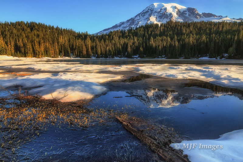Mt Rainier from Reflection Lakes at the end of winter, early July!.  Winter sticks around at these altitudes.