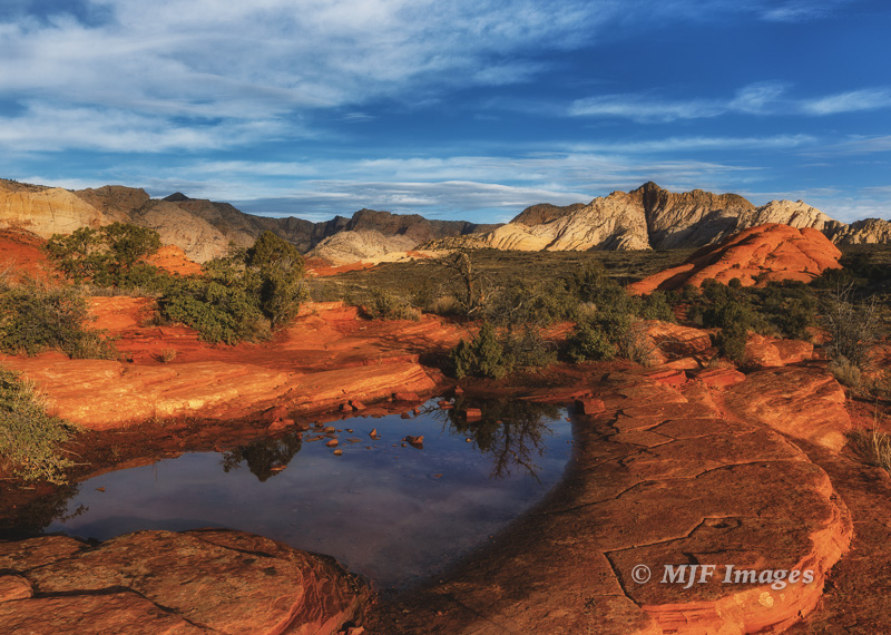 The lower terrain near St. George, Utah is exemplified by Snow Canyon State Park, but the land continues to drop to the south and west.