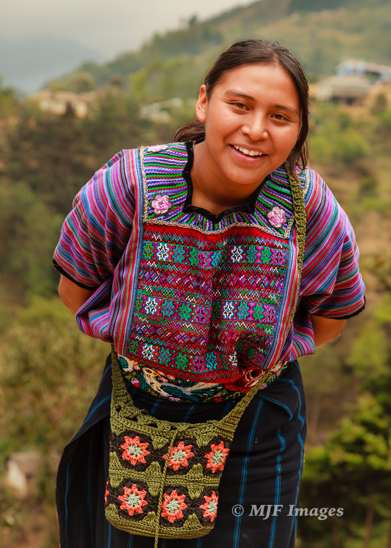 This smiling young Mayan woman from the Guatemalan highlands I shot after having some laughs with she and her friend.  Sort of the opposite of the above image.