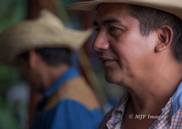 A candid image of a couple Nicaraguan Vaqueros.  Candids can be more objective, without the biases of the relationship between photographer and subject.