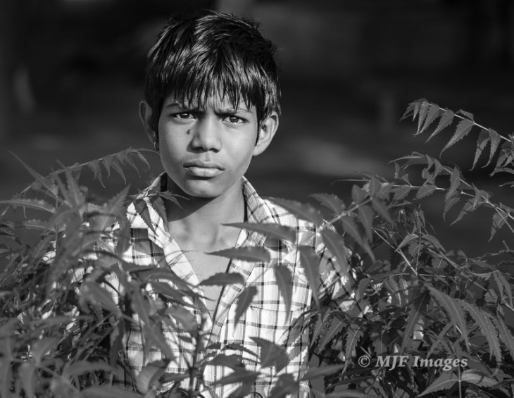 A village boy from northern India gazes at me with what my subjective mind takes as a degree of hostility
