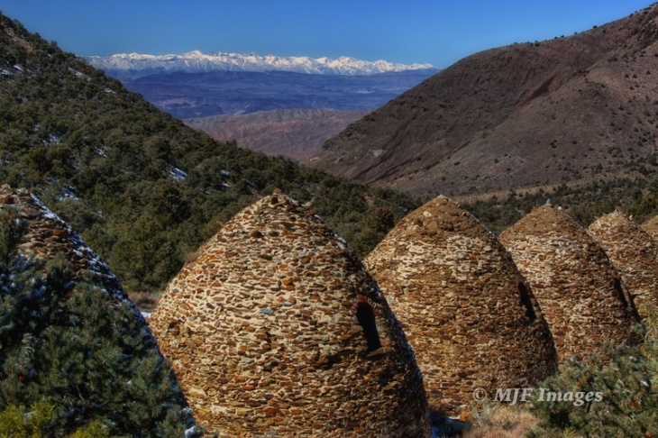 In Death Valley N.P., California, charcoal kilns leftover from the mining era high up in the Panamint Range offer a spectacular view of the snow-covered Sierra Nevada.