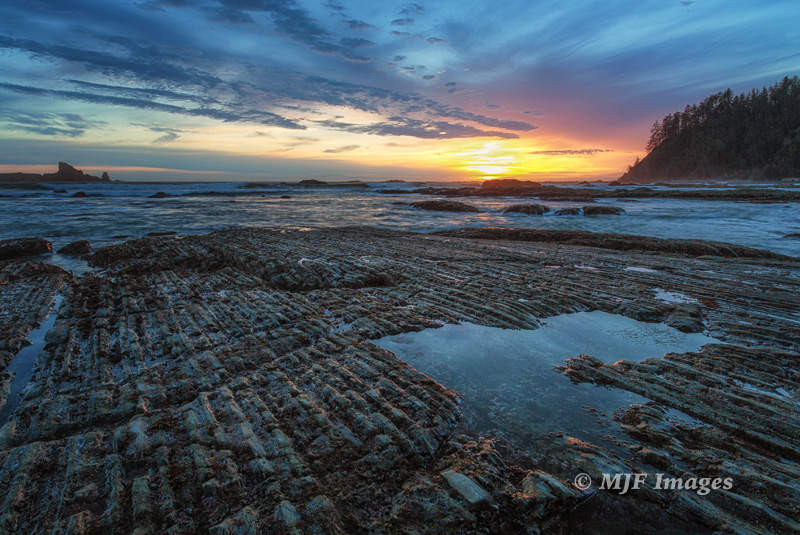 Post-sunset with turbidite sandstone beds standing on their ends, Olympic Coast. 21 mm., 0.5 sec. @ f/11, ISO 50; tripod.
