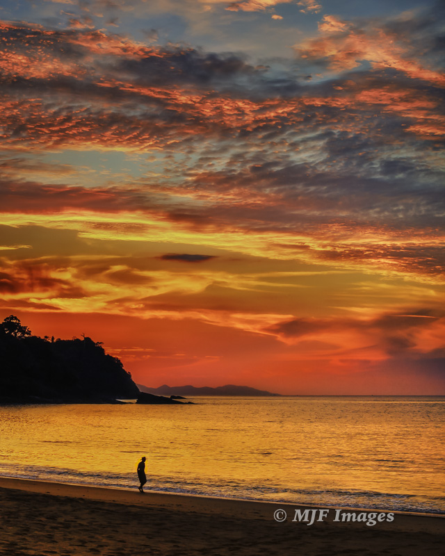 Sunset beach stroll on the lovely Andamon Sea island of Tarutao, Thailand.