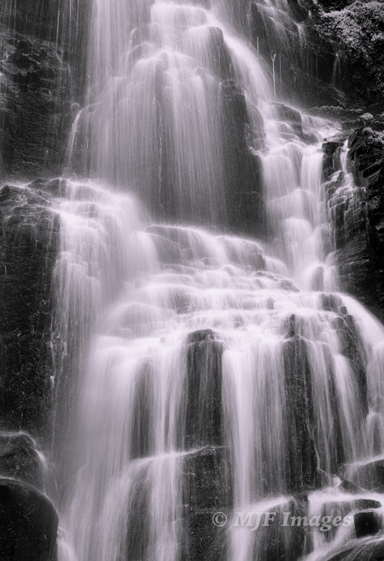 Zooming in on Faery Falls in Oregon's Columbia Gorge, the image became nearly monochrome.  50 mm., 0.4 sec. @ f/11, ISO 50; tripod; Processed in Silver Effex.