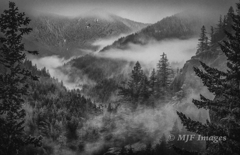 Oregon's upper Salmon River in the Cascade Mtns. is an amazing place to photograph in cold wintry weather.  70 mm., 1/6 sec. @ f/16; tripod; B&W conversion in Silver Effex.