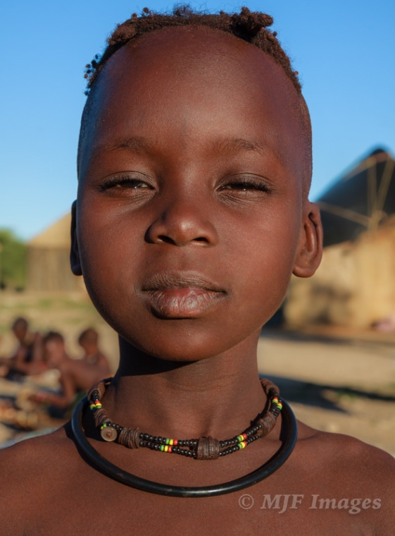 This Himba boy in northern Namibia was cute in how serious he was about standing tall and noble.