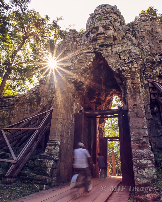 Angkor Wat's West Gate is an easy subject to like, but it took patience and time to shoot it with pedaling commuters and the sun in the right position.