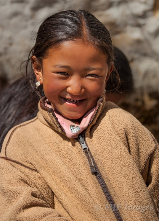 This cute little Sherpa girl, who was shy at first, had such a big playful personality that I had to force myself to stop and get pictures.
