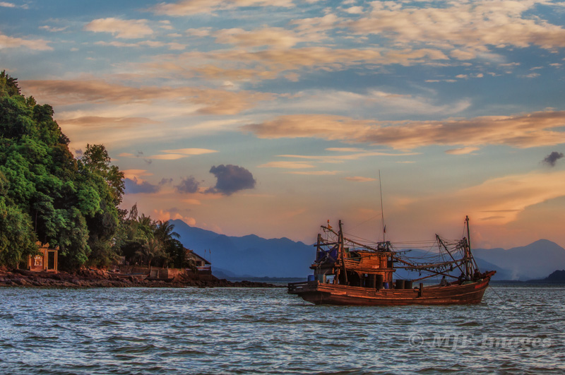 Sometimes you only have a few seconds to get a single shot. That was the case as I hurried to board a ferry. This is a traditional fishing vessel along the coast of Burma (Myanmar).